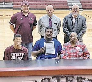 Poteet senior Roderick King poses after signing his letter of intent to play at Fort Scott Community College in Kansas. HANNAH WATTS | PLEASANTON EXPRESS