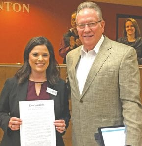 """Pleasanton Mayor Travis Hall presents a proclamation designating February as """"Teen Dating Violence Awareness Month"""" to Andrea Rathmell, Director of Education Outreach at Safer Path Family Violence Shelter. Partner violence in Texas is three times the national average. Only 33% ever tell anyone when experiencing abuse. It can be prevented, the mayor noted, by raising awareness and training. CHRISTELLE TROELL 