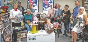 Inviting everyone to the Jourdanton Chamber of Commerce's BBQ and Auction are, left to right: Benita Muckleroy, Jack R. Harrison, Joyce Steinle (seated), Patrice Wassing, Jeanette Harrison, Karen Rakowitz, Dorothy Manning, Annie DeLaO, Jeff Chicoine and Michele Higginbotham. KAREN RAKOWITZ | COURTESY PHOTO