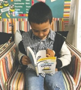 Pictured is second grader Jermie Hernandez reading. SHERYL MILLS | COURTESY PHOTOS