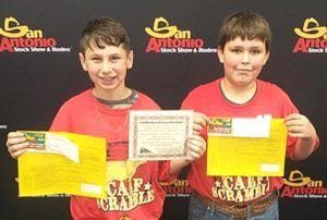 Hayden McDonald and Dalton Wilson earned their $1,200 certificate for catching a calf in the Calf Scramble at the San Antonio Stock Show and Rodeo. COURTESY PHOTO