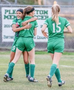 Trinity Garcia (9) and Brylee Miller (15) run to celebrate a goal with teammate Madelyn Bird (11) in Pleasanton's 4-0 win over La Vernia on March 6. The win clinched the fourth consecutive district championship for the Women Eagles. They were scheduled to start their playoff run before the UIL suspended all spring sports due to COVID-19. J GARCIA | PLEASANTON EXPRESS