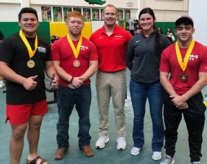 (Left): Kylie Bosquez stands on the podium after finishing third at the regional meet and qualifying for state. (Top)L-R: Isaac Paredes, Carlos Verdin, Head Coach James Martin, Assistant Coach Jessica Vrana and Dedrick Querner at the Region V powerlifting meet at Bishop High School. Bosquez, Paredes and Querner each qualified for the state meet. However, due to the COVID-19 outbreak, the meet has been postponed indefinitely. CONTRIBUTED PHOTO
