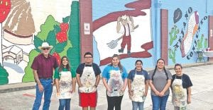 Members of the Poteet Art Club pose with Poteet Mayor Willie Leal in front of the incompleted murals during Spring Break on March 11. The students completed the murals on Friday, March 13. Please see completed murals on 2A. Pictured, from left, are Mayor Leal, Rabya Ali, Jacob De La Garza, Melody Peña, Dalia Montes, Liliana Gonzalez and Ruth Olivares (teachers). REBECCA PESQUEDA | PLEASANTON EXPRESS