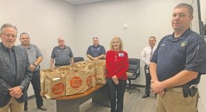 """H-E-B, Pleasanton, #411, Top Store Leader, Aubrey Olle Smith is pictured with Pleasanton Mayor Travis Hall, Police Chief Ronald Sanchez, Fire Chief Chuck Garris, Detective Johnny Haren, City Manager Johnny Huizar and Detective Phillip Glass at the Emergency Office Center (EOC) in Pleasanton. H-E-B recognizes that across the state there are many local nonprofits on the front lines working hard to help the communities they serve, and has pledged $1 million in financial support as part of their """"My Community Investment"""" program to nonprofit partners who are providing vital services during this time. H-E-B recently donated $1,000 to the EOC to help feed the elderly and families in need of groceries in Pleasanton. If you have questions about COVID-19, please feel free to call the Pleasanton Emergency Management Office at 830-569-2813 or email them at pleasantoneoc@pleasantontx.gov"""