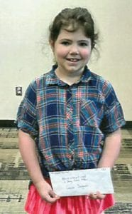 Jaycee Delgado, pictured above, is one of the winners in the first and second grade category. Toby Jones and Sadie Delgado were absent.