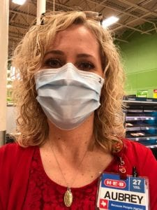 Pleasanton H-E-B Top Store Leader Aubrey Olle Smith wears a protective mask while at work. H-E-B released a new recommendation that all employees wear one while at work. AUBREY SMITH | COURTESY PHOTO