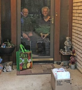 Ann and Ken Smelley visit with their daughter, Coral, while following social distancing protocols. The parents earned the care package hall of fame with toilet paper, paper towels, meat, masks and homemade brownies.