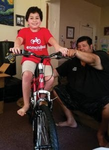 Pictured are Gene Anthony Vasquez, 4th grade Earn-a-Bike participant and his father, Eugene Vasquez.
