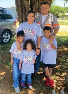 Samuel, Ethan, Gabriel, Roxanne and Fernando Nuncio wear their CHD Awareness shirts made by E&V Kustoms during the benefit plate sale this past Saturday.