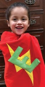 """Ethan wears his cape from TinySuperheroes company where they call him """"Super Ethan."""""""
