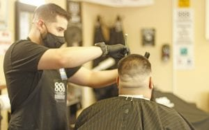 888 Classics barber Raymond Galvan opened up shop with COVID-19 safety precautions on May 8. Galvan and his fellow barbers had a full day of cutting hair in Lytle. GABRIEL ROMERO | PLEASANTON EXPRESS