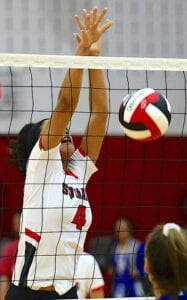 Jourdanton's Isela Wilson (4) lands a block in their 2019 season opener against Somerset. SAM FOWLER | PLEASANTON EXPRESS