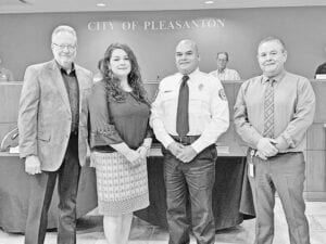 Mario Escobedo, second from right, was sworn into office on May 30 during the regular meeting of the Pleasanton City Council as the new Pleasanton Fire Department Fire Chief. Pictured, from left, are Pleasanton Mayor Travis Hall, Veronica Escobedo (wife), Fire Chief Escobedo and Pleasanton City Manager Johnny Huizar. REBECCA PESQUEDA | PLEASANTON EXPRESS
