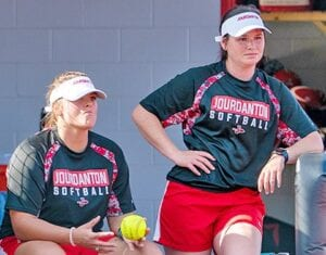 Lexi Smith (left) and Jessica Vrana (right) perch on the top step of the dugout during a game in 2020. Smith resigned as Head Coach in early June to take another coaching job. Vrana was promoted to fill the vacancy. J GARCIA   PLEASANTON EXPRESS