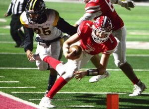 Jourdanton QB Cole Andrus dives for the pylon against Lytle in 2019. Andrus is one of 13 starters returning for the Indians in 2020. SAM FOWLER | PLEASANTON EXPRESS