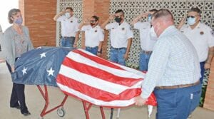 Members of the Jourdanton Volunteer Fire Department, from left, Fire Chief Jay Fojtik, Captain Amy Balderas, Firefighter Izzy Martinez, Captain Charlie Abshier and Captain Jeff Rankin salute as Hurley Funeral Home directors escort Atascosa County Emergency Management Coordinator and former Jourdanton Volunteer Fire Department Chief David Prasifka into the funeral home on Monday, July 6. JOE DAVID CORDOVA | PLEASANTON EXPRESS