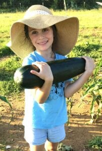 """Kinsley Chain, 5, with her 17"""", 6.5 lb. zucchini squash. Lachelle and Wesley are the proud parents of Kinsley and they all happily reside in Jourdanton. COURTESY PHOTO"""