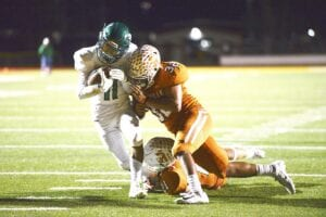 Pleasanton's Alonzo Duran fights off a Beeville Jones tackle during their meeting on Nov. 1, 2019. PLEASANTON EXPRESS FILE PHOTO