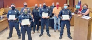 Officers Steven Vera, Alexia Delgadillo, Matthew DeLeon and Sgt. Kai Viesca were honored at the Pleasanton City Council meeting on July 16 for their work to save a man's life. Pictured, from left, back row, Councilman Kenneth Hernandez, Mayor Travis Hall, Jr.; middle row, Council Members Robert Leonhardt, JR Gallegos, Robert Earl Wood, Britni Van Curan on the tablet, Diana Prasifka; front row, Officers Steven Vera, Alexia Delgadillo, Matthew DeLeon and Sgt. Kai Viesca. COURTESY PHOTO