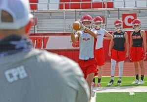 Jourdanton sophomore receiver Jace Hierholzer concentrates on a pass thrown by receivers coach Truman Regan at their first practice of the 2020 season on Aug. 3. SAM FOWLER | PLEASANTON EXPRESS
