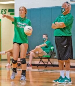 Pleasanton sophomore outside hitter Sadie McAda (left) talks with Head Coach Gabriel Aguirre during their scrimmage against Lytle on Saturday, Aug. 8. McAda figures to be a key component in the Lady Eagles' 2020 campaign. J GARCIA | PLEASANTON EXPRESS