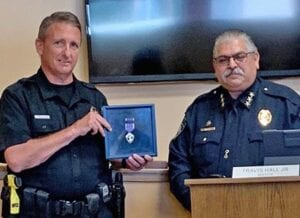 Pleasanton Chief of Police Ronald Sanchez, right, presents Louis Tudyk with the Purple Heart Medal of Honor during the Pleasanton City Council meeting on Aug. 6. COURTESY PHOTO