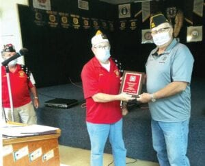 John E. Shipley, Commander of Post 6970 in Poteet, received the Outstanding Immediate Past District 20 Commander Award by the Texas Veterans of Foreign Wars. Making the presentation is Herman Hood, Senior Vice Commander.