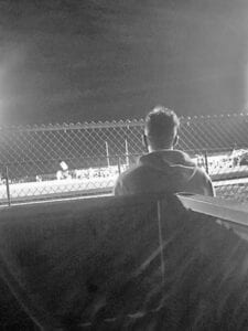 Payton Gonzales watches from outside Indian Stadium as Jourdanton played Calallen on Sept. 4. Gonzales couldn't play in the game because he was quarantined after potentially being exposed to COVID-19. PHOTO COURTESY OF CANDI MYERS