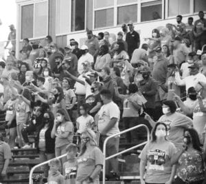 Fans, some masked and some not, stand to sing the Pleasanton Alma Mater before the Eagles met with Jourdanton in the Highway 97 Shootout on Friday, Sept. 11. SAM FOWLER | PLEASANTON EXPRESS