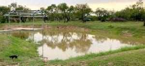 Savana Conner of Pleasanton, off Hwy 97 & IH 37, caught enough rain to fill their pond up halfway when it was just a hole in the ground a few hours before. COURTESY PHOTO