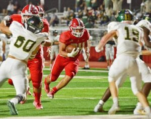 Aidan Borth (24) tries to find a running lane for one of his two touchdowns in Jourdanton's 38-24 win over Canyon Lake on Friday, Sept. 18. SAM FOWLER | PLEASANTON EXPRESS