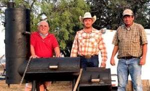 """Robert """"Doc"""" Williams, Pleasanton Young Farmers President, T.J. Reich and James House of House Construction. James was the winner of the bbq pit donated by MG Building Materials. COURTESY PHOTO"""
