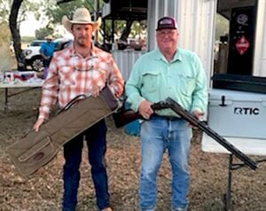 Pleasanton Young Farmers President, T.J. Reich and Mike Shearrer. Mike won the CZ All American Over and Under 12-guage shotgun with a custom case. COURTESY PHOTO