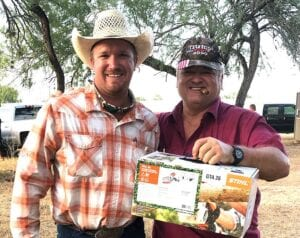 Pleasanton Young Farmers President, T.J. Reich and Randy Shearrer. Randy was the winner of the Stihl GTA26 hand-held power saw. COURTESY PHOTO