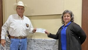 Atascosa County Sheriff David Soward turns in a check for $25,000 to County Treasurer Laura Pawelek for out-of-county inmate housing. In total, for the months of May, June and July 2020, the ACSO Jail brought in a total of $173,770. REBECCA PESQUEDA | PLEASANTON EXPRESS