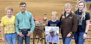 """Grandchildren of A.L. """"Windy"""" Miller join their grandmother, Laurie Miller, SCTICA President, in viewing a roping saddle in their grandfather's memory sponsored by Lube Works and 2C Brangus Ranch, Brad and Debra Cotton. Left to right: Ryann Miller, Wyatt Miller, who participated in the roping and won second in the #12, Travis Miller and Ashley Miller. (Kyle and Makayla not shown) COURTESY PHOTO"""