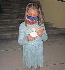"""Kyleigh Alvarado, age 7, was in attendance at the Safer Path """"Shine A Light"""" Vigil on Oct. 8. She is the granddaughter of Rusty and Diana Prasifka of Pleasanton. Parents are Allison Prasifka and Cipriano Alvarado. NOEL WILKERSON HOLMES   PLEASANTON EXPRESS"""