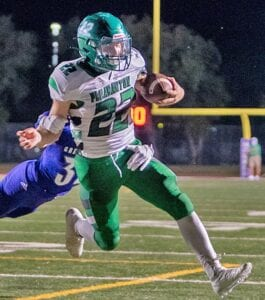 Toby Garner sheds a Boerne tackler to rush into the end zone for one of his two touchdowns of the night in a 45-20 loss on Oct. 9. Friday night was Garner's third consecutive game with over 100 yards rushing. J GARCIA | PLEASANTON EXPRESS
