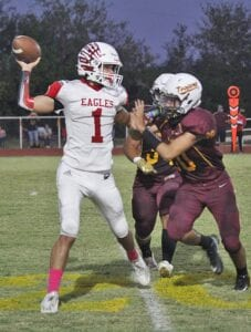 Joe Cantu tries to put a hit on the Benavides quarterback during Charlotte's 58-0 rout on Oct. 9. GABRIEL ROMERO | PLEASANTON EXPRESS