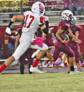 Andru Castillo (6) races past a Benavides defender during Charlotte's 58-0 rout on homecoming. Castillo finished with 71 yards rushing, 70 yards receiving and four total touchdowns to help the Trojans to their first 3-0 start to district play in over 15 years. MARGARET GALLEGOS | PLEASANTON EXPRESS