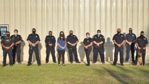 Poteet Police Department, from left, front row: Ofc. Maldonado, Chief Hickman, Jennifer Hickman, Faye Oldham, Lt. Rodriguez, Ofc. Steinort and K-9 Kira; back row: Sgt. Butler, Ofc. Gonzalez, Ofc. Garcia, Ofc. Carter and Cpl. Permenter. JENNIFER HICKMAN   COURTESY PHOTO