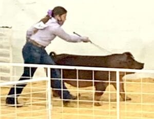 Macy Powell pictured with her Duroc at the Texas State Fair. COURTESY PHOTO