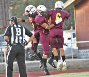 Max Rowland (3), Luis Deleon (8) and Andru Castillo (6) celebrate a touchdown during Charlotte's win over Benavides on Oct. 9. MARGARET GALLEGOS   PLEASANTON EXPRESS
