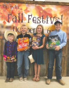 Grant Parrish, Ben Anderson, Alexa Parrish and Levi Anderson (left to right) are excited about the Fall Festival at Cowboy Fellowship on Saturday. LYNSE PAWELEK   COURTESY PHOTO