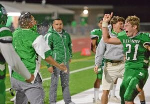 Jayce Krauskopf (21) beams from ear to ear after dousing Head Coach Stephen Liska with Gatorade following the Eagles' 30-7 win over Uvalde on Oct. 23. The win was Pleasanton's first district win since Nov. of 2017. SAM FOWLER | PLEASANTON EXPRESS
