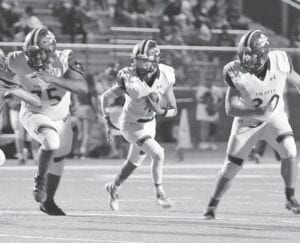 Mark Cantu (4) follows his blockers Roberson Harold (75) and Vincent Casanova (20) for a gain against Cole on Friday night. KYLIE MASK | LYTLE ISD