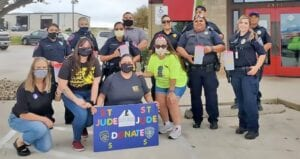 The Pleasanton and Jourdanton Police Departments along with Chili's in Pleasanton raised $6,247 during their 5th Annual Battle of the PDs event that raised funds for St. Jude Children's Research Hospital on Oct. 23. Pictured, from left, front row are Chili's General Manager Shannon Donaghue, Ashleigh Talamantez, Natalie Clarke and Manager/Hope Captain Jennifer Alaniz; back row, Pleasanton Ofc. Daisy Herrera, Sgt. Jess Chia, Ofc. Alexia Delgadillo, Detective Chris Treviño, Jourdanton Sgt. Mari Kaufman, Ofc. Amelia Camacho, Ofc. Juan Rios, Ofc. Kori Martinez and Ofc. TJ Villasana. DESIREE LOSOYA | COURTESY PHOTO
