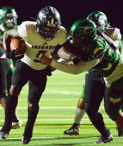 Austin LBJ running back Daqwon Donaldson (5) breaks through senior Ty Hehman's (45) grasp for a touchdown in the first quarter of Pleasanton's 61-0 loss in the bi-district round of playoffs. The Eagles finish the season 3-8 with the program's first trip to the playoffs since 2017. SAM FOWLER | PLEASANTON EXPRESS