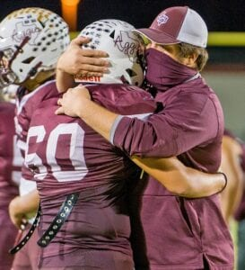 Poteet Head Coach Darby House consoles and thanks senior offensive lineman Jonathan Lopez (60) following the Aggies' 35-20 loss to Blanco in the bi-district round of playoffs on Friday night. J GARCIA | PLEASANTON EXPRESS
